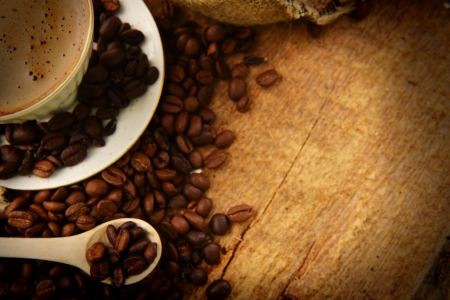 Roasted coffee beans with cup on jute hessian background Stock Photo - 15765806