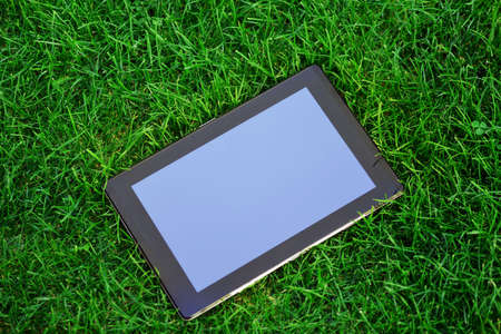 touchpad: generic tablet computer (tablet pc)  on green grass