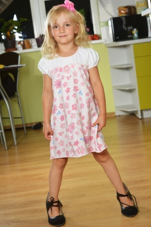 Funny little girl in her mothers big shoes photo