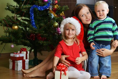 happy children with mother near Christmas tree Stock Photo - 16312576