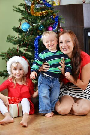 happy children with mother near Christmas tree Stock Photo - 16312563