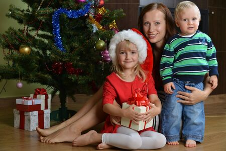 happy children with mother near Christmas tree Stock Photo - 16774645