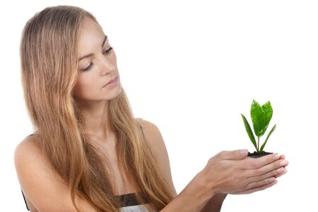 Beautiful young woman with green sprout of tree in her palms Stock Photo - 16776153