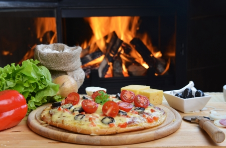 pizza oven: baked tasty pizza  near wood oven