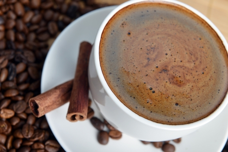 Cup of coffee on saucer and coffee beans Stock Photo - 17780575
