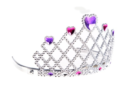Tiara with pink and purple stones on white photo