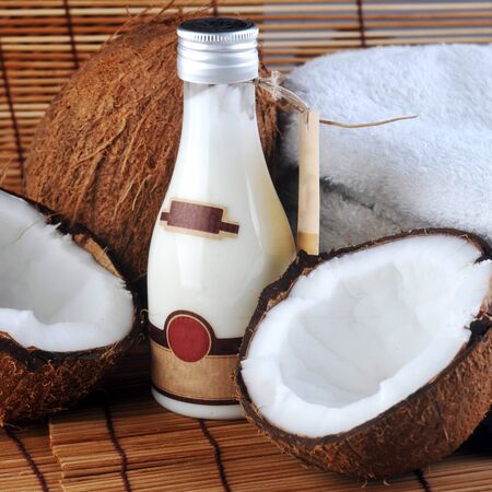 Coconut and massage oil for  body on straw napkin photo