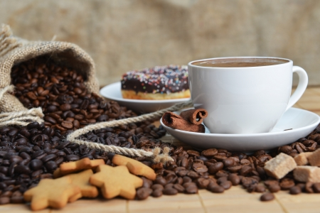 Cup of coffee on saucer and coffee beans Stock Photo - 17995130