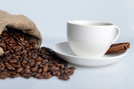 cup of coffee and dark brown roasted coffee beans Stock Photo - 17995004