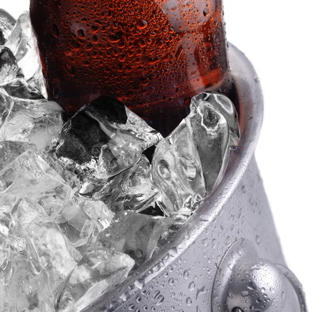 beer bucket:  brown beer bottle in ice bucket with condensation