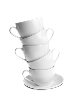 houseware: white coffee cups with saucers. Isolated Stock Photo