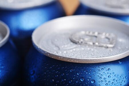 wet aluminium can with drink, close-up of top   photo