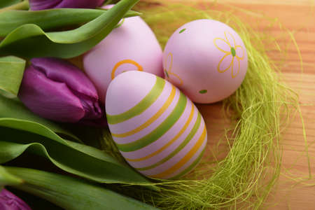 Colorful painted easter eggs  and bouquet tulip photo
