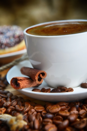 Cup of coffee on saucer and coffee beans photo