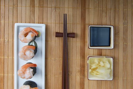 dish with fresh sushi rolls on bamboo napkin background  photo