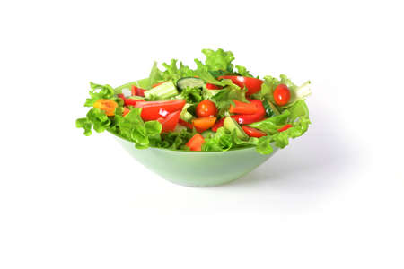 salad with lettuce and other fresh vegetable on white dish. photo
