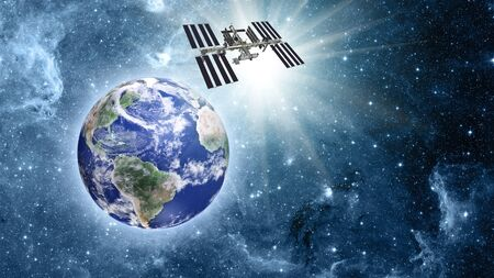 space station: Space station over blue planet earth in space. Stock Photo