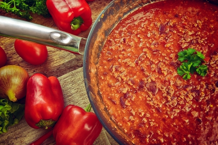 pan of hot chili con carne, ready to serve. photo