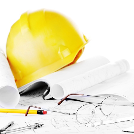 construction plans: Yellow helmet and heap of project drawings Stock Photo