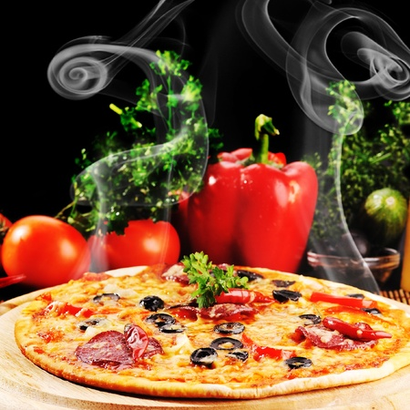 Tasty pizza on  wooden plate close up photo