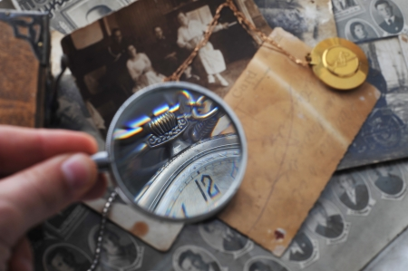 pocket clock with  chain on background of old photos photo