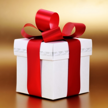 Christmas present with red ribbon close up photo