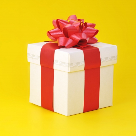 gift box  close up isolated on yellow background  photo