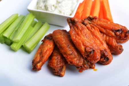 chicken wings with celery, carrot and blue cheese sauce photo