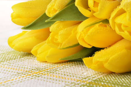 blosom: bouquet of fresh yellow tulips on table
