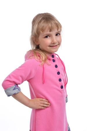 smug: Studio photo of adorable little girl in pink dress Stock Photo