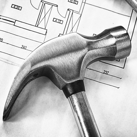steel claw hammer isolated on design and project drawings photo