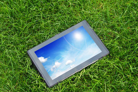 generic tablet computer (tablet pc)  on green grass photo
