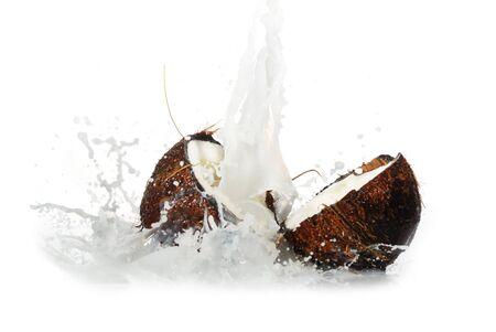 cracked coconut with big splash, isolated photo