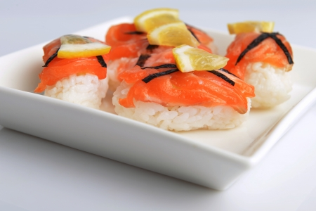 sushi with salmon and lemon on  plate photo