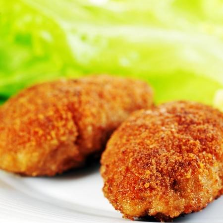 roasted cutlets of pork with potato and  lettuce photo