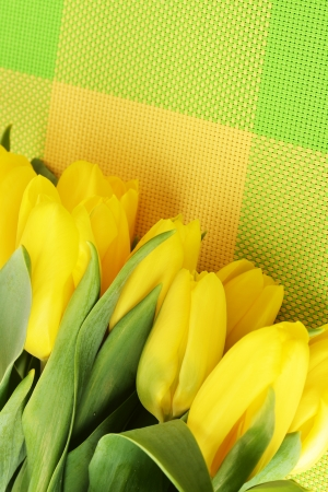 bouquet of fresh yellow tulips on table photo