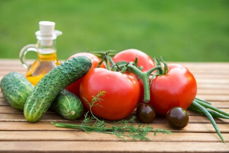 fresh cucumber and tomatoes on wooden table  photo