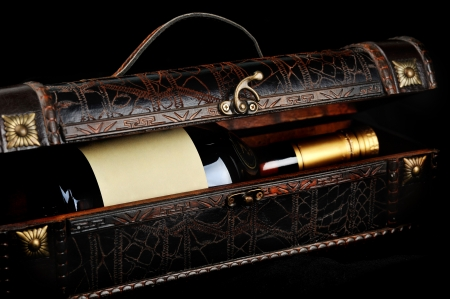 Cognac bottle in wooden case  background photo