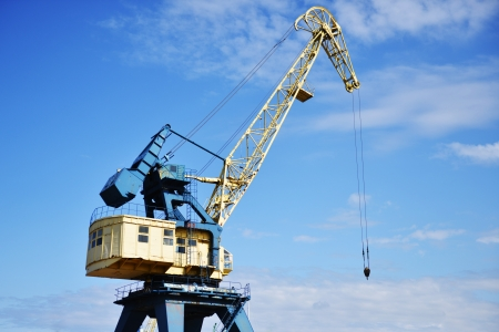 Port crane lowered  boom  in port Stock Photo - 21741092