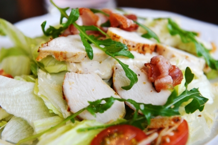 salad  of vegetables and slices of chicken meat photo