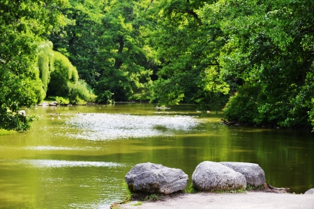 flowing river: three large stone on  bank of  river. summers day