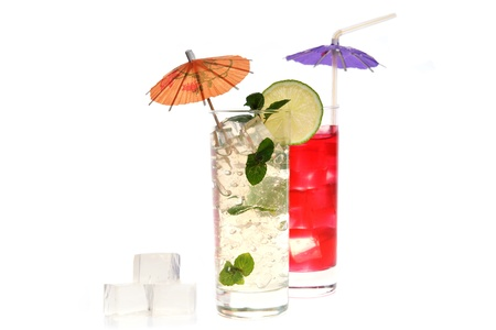 cocktail in wineglasses with lime, mint and umbrella photo