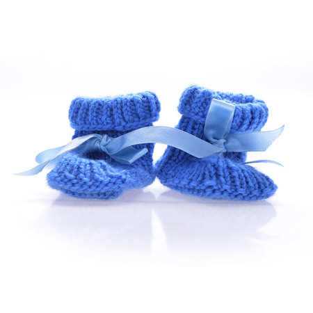 Handmade  baby booties isolated on a white background photo