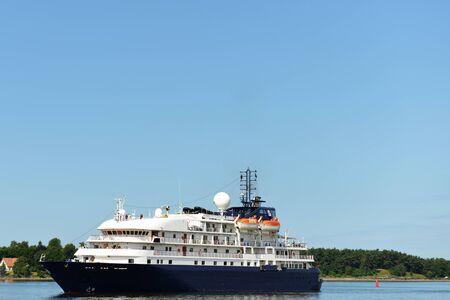 Big luxury cruise ship floating near shore
