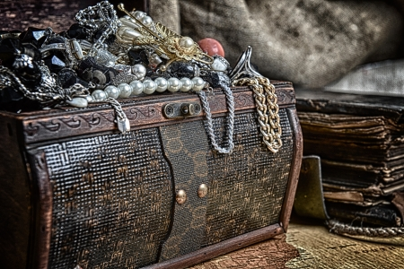 Wooden treasure chest with valuables. beads, necklaces and other jewelry photo