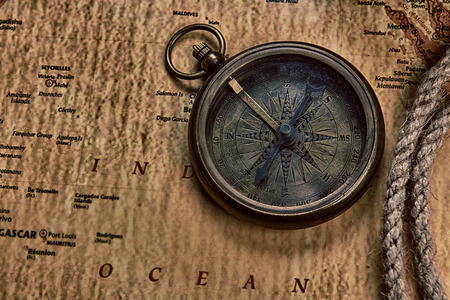 vintage world map: old compass on vintage map and  rope