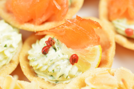 tartlets with cheese sauce and salted salmon photo