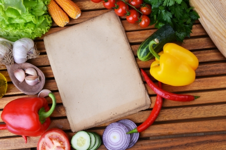 fresh vegetables and olive oil on wooden background Stock Photo - 24290757