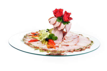 thinly: Thinly sliced pieces of meat on  plate