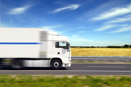 freight traffic: truck with freight moving fast